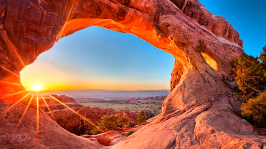 Sunrise at Partition Arch, in Arches National Park.